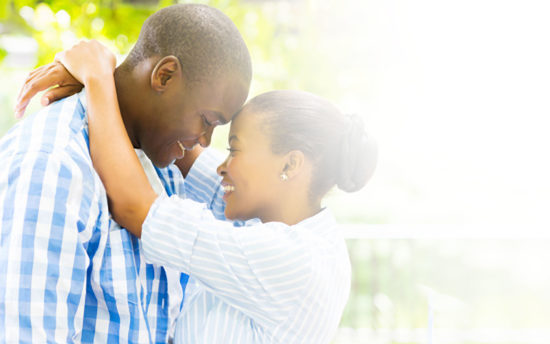 couple hugging after boyfriend released on bail bonds